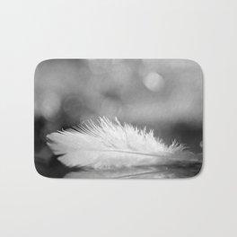 White Feather In Black And White Bokeh Background #decor #society6 #buyart Bath Mat