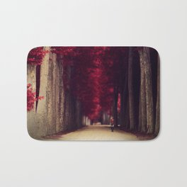 Red colors of autumn, surreal photo, red trees, alley in a park Bath Mat