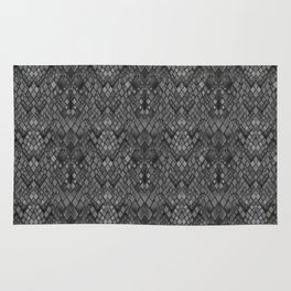 Abstract and faux crocodile skin .Texture Dark gray . Rug
