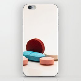 Numerous medicines Medications in the form of tablets. Colored pills on a white background. iPhone Skin