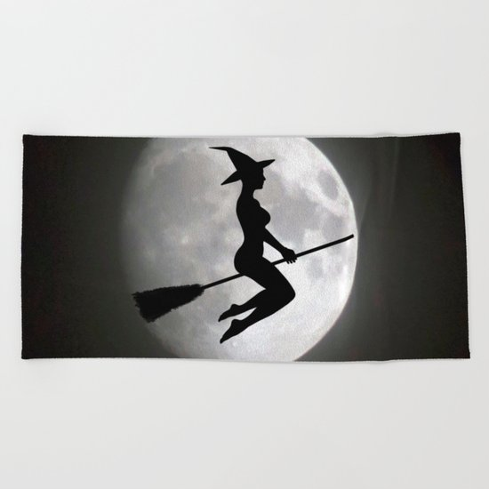 Witch On a Broom Against the Moon Beach Towel