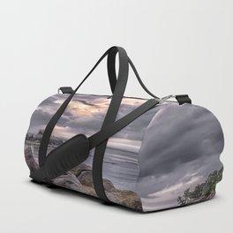 Cloudy beach sunset Duffle Bag