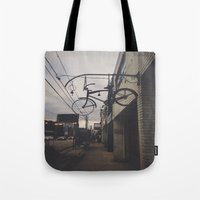 bicycles Tote Bags featuring Bicycles by Wanderlust Fhotos