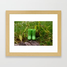 Boots in the grass Framed Art Print