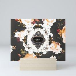 resist moths on dark floral Mini Art Print