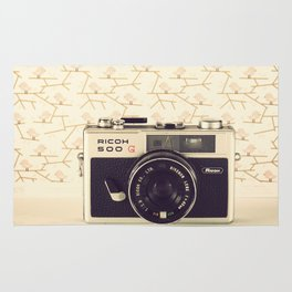 Ricco Film Camera and Pink Background Birds (Vintage and Retro Still Life Photography)  Rug