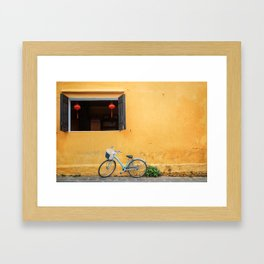 Bicycle and yellow wall. Framed Art Print