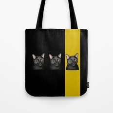 Three Black Cats with Black and Yellow Background Tote Bag