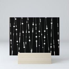 Pearl beads on black background garland Mini Art Print