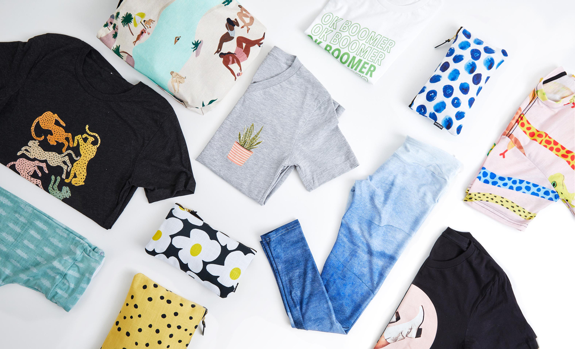 flatlay with t-shirts leggings and pouches