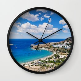 The village of Lindos with a beautiful bay, medieval castle and pictursque houses in Rhodes, Greece. Wall Clock