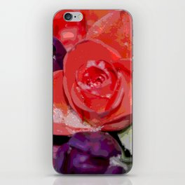 Snow settling on a top of Bouquet of flowers iPhone Skin