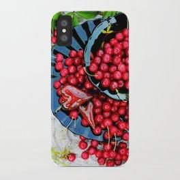Cherries on black plates iPhone Case