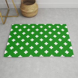 White Swiss Cross Pattern on Green background Rug