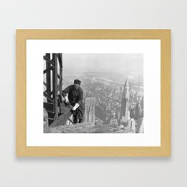 A construction worker on top of the Empire State Building in 1930, New York. Framed Art Print