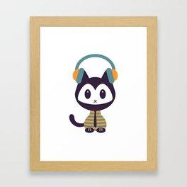 Cute kitten in headphones Framed Art Print