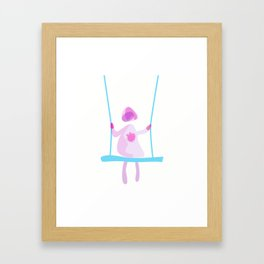 Blushed girl on a swing Framed Art Print