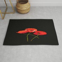3 Poppies on Black Rug