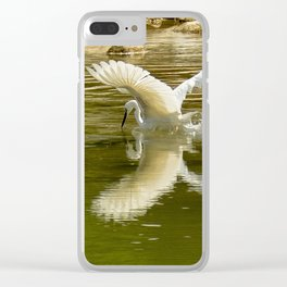 The heron lays on the placid river... Clear iPhone Case