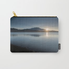 View of the sun rising over the mountaintop from across the lake Carry-All Pouch