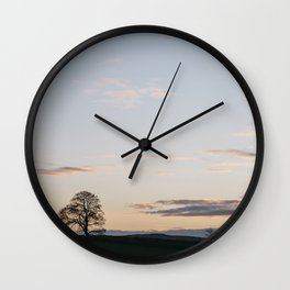 Tree on a hilltop above Matlock silhouetted at twilight. Derbyshire, UK. Wall Clock