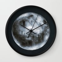 dark side of the moon Wall Clocks featuring The Dark Side of the Moon by Viviana Gonzalez
