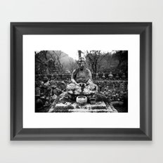 Buddha in the snow Framed Art Print