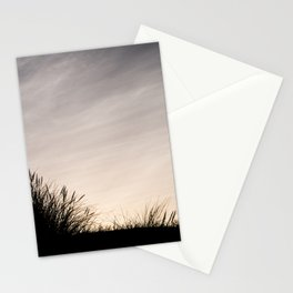 Silhouette in grass and clouds Stationery Cards