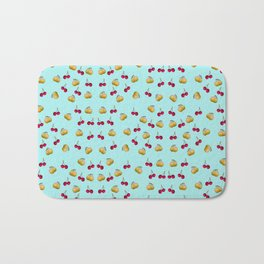 cherries and plums on a blue background Bath Mat