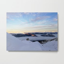 Morning light sweeping mountain peaks above sea of clouds Metal Print