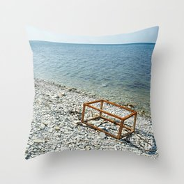 Sea and rusty frame box on shore Throw Pillow