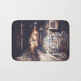 Lower East Side - Midnight Warmth on a Snowy Night Bath Mat