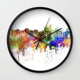 Prato skyline in watercolor background Wall Clock