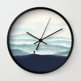 Girl looks at the mountains Wall Clock