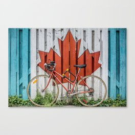 A Fence with the Canadian Maple Leaf and a Bicycle Canvas Print