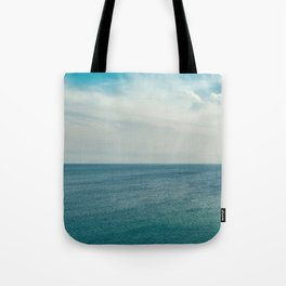 Cliff into the ocean Tote Bag