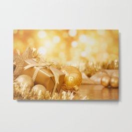 Christmas scene with gold baubles and gift, gold background Metal Print