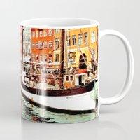 denmark Mugs featuring Copenhagen, Denmark by Philippe Gerber