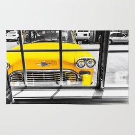 vintage yellow taxi car with black and white background Rug