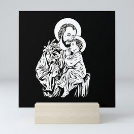 Saint Joseph holding jesus in his arm Mini Art Print