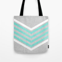 monika strigel Tote Bags featuring Teal and White Chevron on Silver Grey Wood by Tangerine-Tane