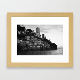 Black and white photo of a favela taken from the water Framed Art Print