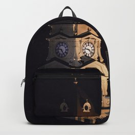 Crescent moon and earth shine at city hall clock tower Backpack