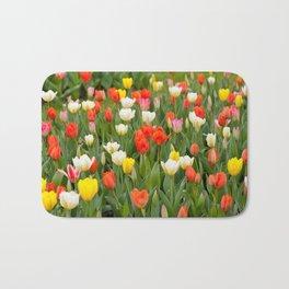 Plenty tulips mix grow in garden Bath Mat