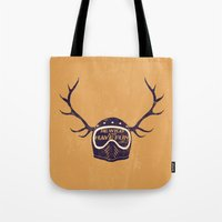 into the wild Tote Bags featuring wild by The Junkers
