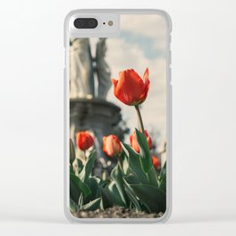 Tulips in front of a fountain. Clear iPhone Case
