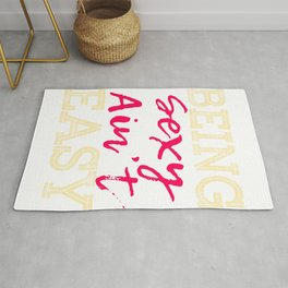 """Stay cool and revealing with this cool tee that matches your mood! """"Being Sexy Ain't Easy"""" tee! Rug"""