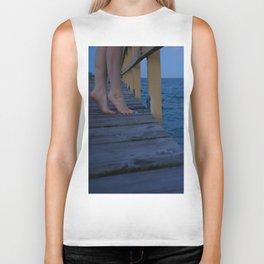 Woman standing on the edge of a pier Biker Tank