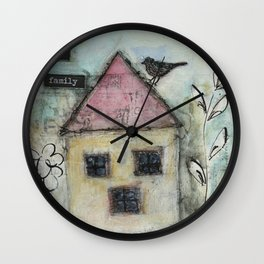 Home is family Wall Clock