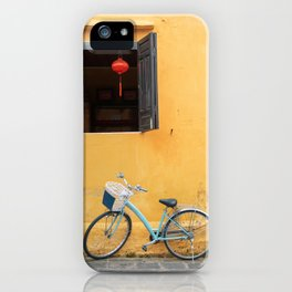 Bicycle and yellow wall. iPhone Case